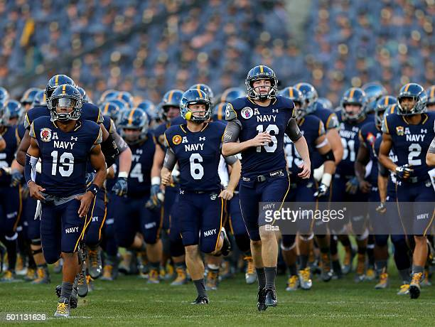 The Navy Midshipmen run off the field after warm ups before the game against the Army Black Knights at Lincoln Financial Field on December 12 2015 in...