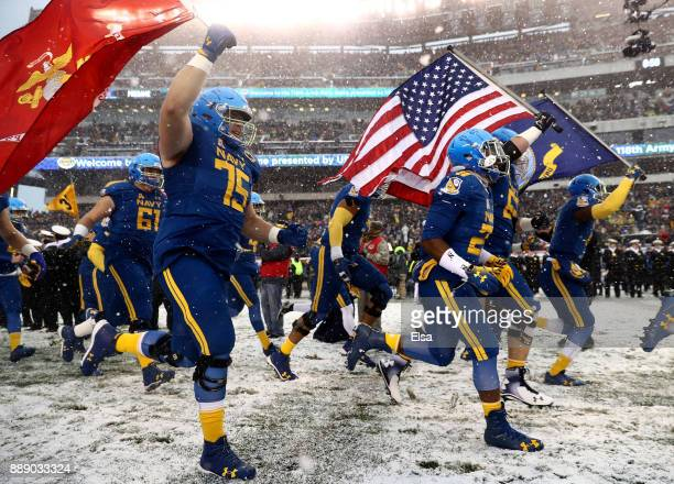 The Navy Midshipmen run out on the field before the game against the Army Black Knights on December 9 2017 at Lincoln Financial Field in Philadelphia...