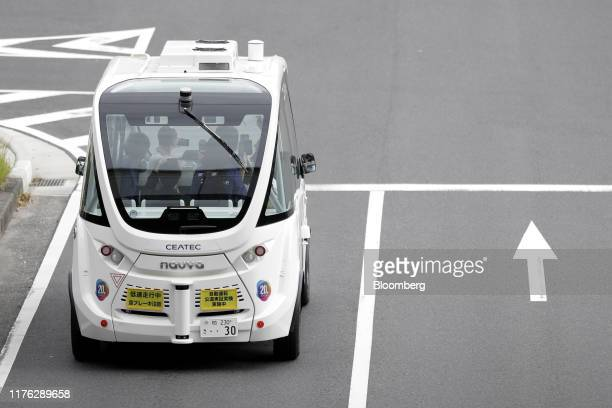 The Navya Arma autonomous shuttle bus manufactured by Navya Technologies SAS travels during a test drive at the Combined Exhibition of Advanced...