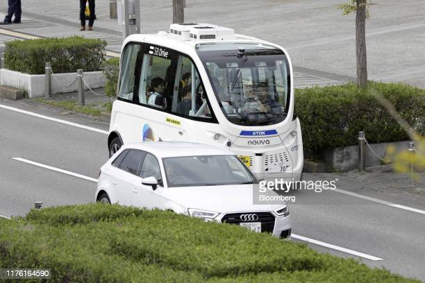 The Navya Arma autonomous shuttle bus manufactured by Navya Technologies SAS top travels during a test drive at the Combined Exhibition of Advanced...