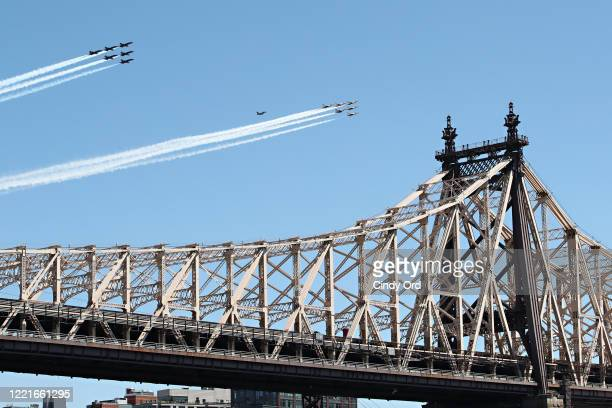 The Navy's Blue Angels and the Air Force Thunderbirds fly over Ed Koch Queensboro Bridge on April 28, 2020 in New York City. The Blue Angels and...