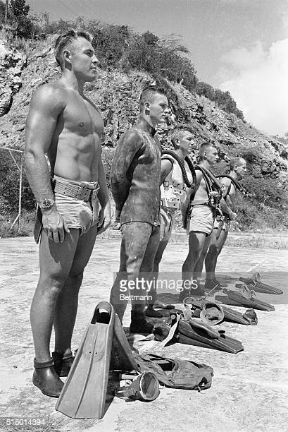 The Navy's human weapon on display reveals five different outfits worn by UDT men Left to right are Ron Damon of Portland ME showing simple skin...