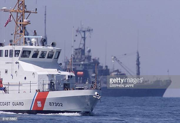 The Navy's USS Grasp sits behind a Coast Guard ship the Hammerhead as divers were viewing the wreckage of John F Kennedy's singleengine Piper...