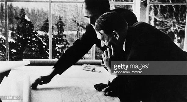 The Nazi architect Albert Speer showing to the German Chancellor Adolf Hitler the urban plans for the new Berlin Obersalzberg 1930s