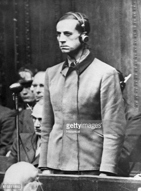 The Nazi Dr Karl Brandt who experimented on humans stands at his trial at Nuremberg 1945