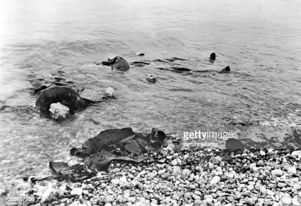 The Nazi propaganda image depicts fallen allied soldiers with swim vests in the water on the shore of the French Dieppe The photo was taken in August...