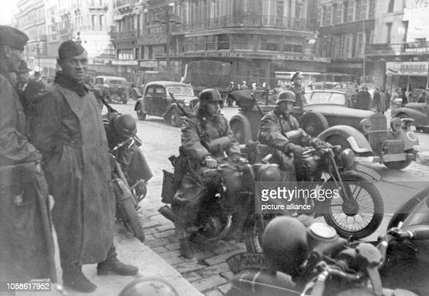 The Nazi propaganda image depicts soldiers of the German Wehrmacht on a main street in Marseille during the occupation of Southern France. The photo...