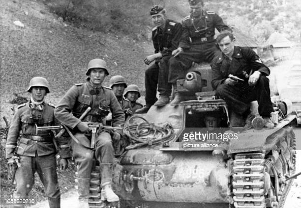 The Nazi propaganda image depicts soldiers of the German Wehrmacht on a captured tank during advance in Yugoslavia in April 1941. Photo: Berliner...