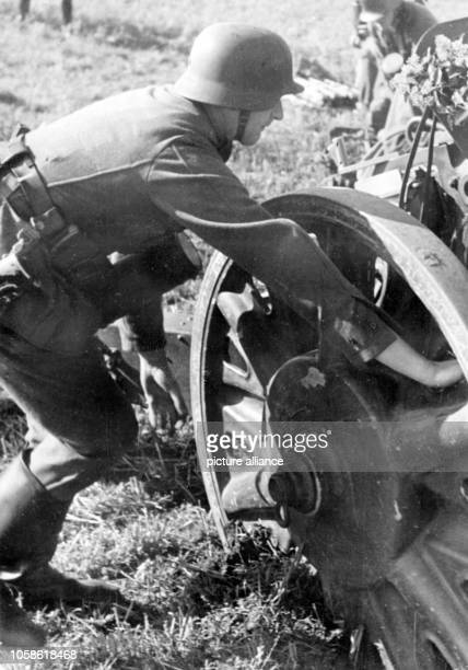 The Nazi propaganda image shows a German Wehrmacht cannoneer setting up a gun on the Western Front Published in February 1941 A Nazi reporter has...