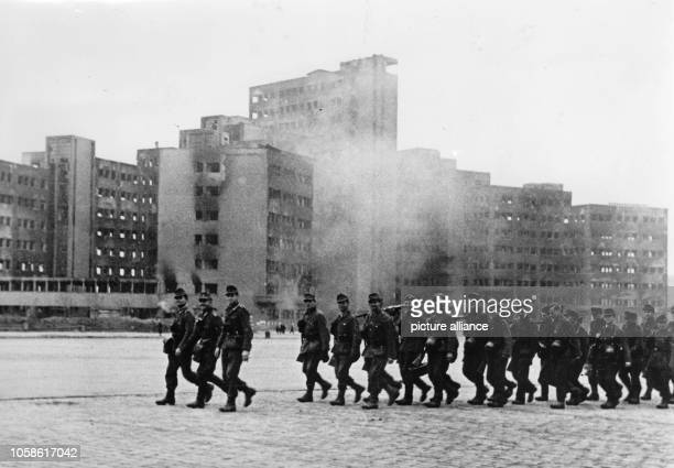 The Nazi Propaganda on the back of the image reads Soldiers of the German Mountain Infantry march across the Dzerzhinsky Square in Kharkiv Image from...