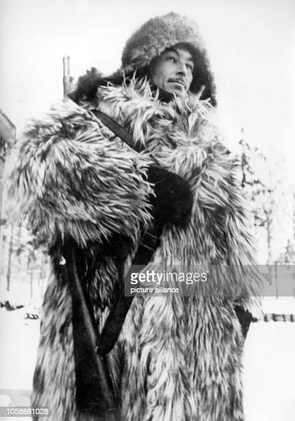 The Nazi propaganda picture shows a guard of the German Wehrmacht in a fur coat and cap in winter on the Eastern Front The photo was taken in March...