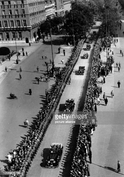 The Nazi propaganda picture shows a parade of Nazi Party officials driving down Unter den Linden on Pariser Platz seen from the Brandenburg Gate in...