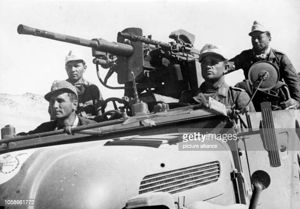 The Nazi propaganda picture shows a patrol of the German Wehrmacht with machine guns on a vehicle with a scorpion symbol on the hood in Tunisia The...