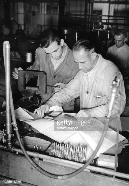 The Nazi propaganda picture shows a student from Schönbrunn and his supervisor, who is giving him instructions with construction drawings, during...