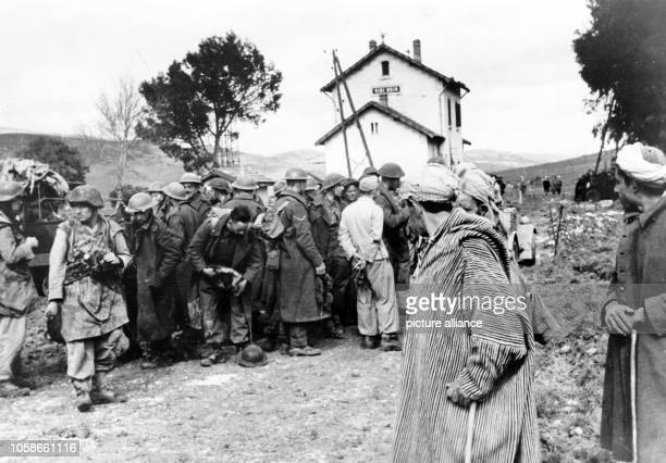 The Nazi propaganda picture shows British prisoners of war of the German Wehrmacht near Oued Sidi Nsir in Tunisia The photo was taken in March 1943...