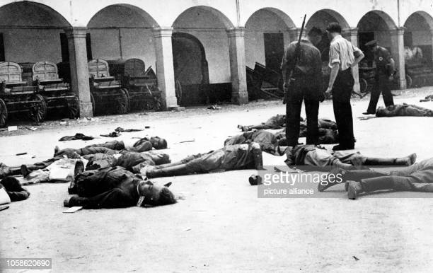The Nazi propaganda picture shows dead bodies lying on the floor in the yard of the Cuartel de la Montaña after the assault by republican authorities...