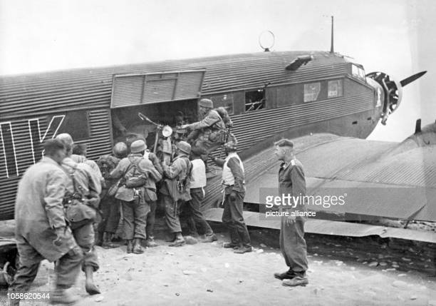 The Nazi propaganda picture shows German soldiers on the Greek island of Crete The Nazi propaganda caption on the back of the photo writes on 31 May...