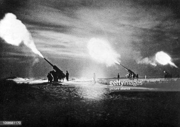The Nazi propaganda picture shows Italian antiaircraft gun positions in North Africa during a nightly attack The photo was issued in January 1943...