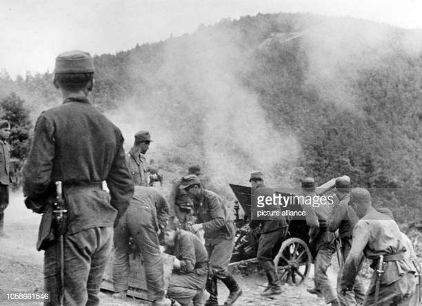 The Nazi propaganda picture shows members of the 13th Waffen Mountain Division of the SS Handschar firing a gun during the partisan combat in...