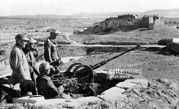 The Nazi propaganda picture shows soldiers of the German Wehrmacht at an antiaircraft position in Tunisia The photo was taken in March 1943 Photo...