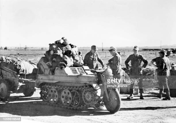 The Nazi propaganda picture shows soldiers of the German Wehrmacht on a halftrack motorbike type HK 101 in Tunisia The photo was taken in January...