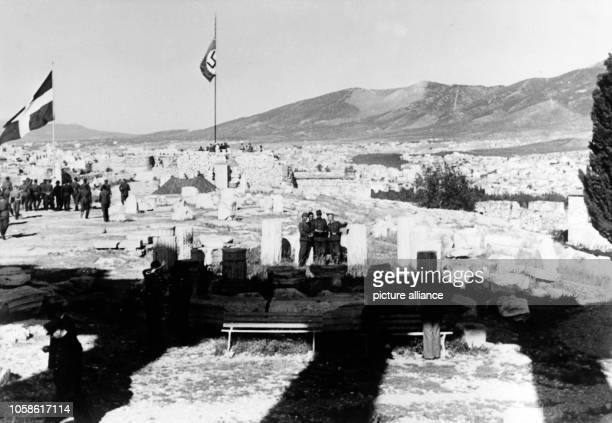 The Nazi propaganda picture shows soldiers of the German Wehrmacht on the Acropolis of Athens after the conquest of the city. The Greek flag and the...