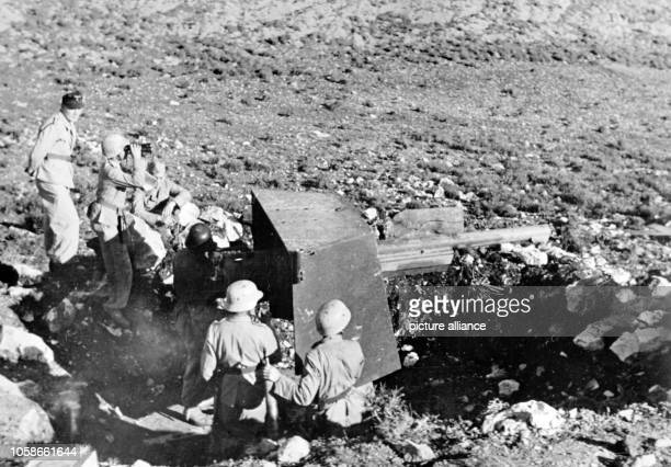 The Nazi propaganda picture shows soldiers of the German Wehrmacht on a cannon in Tunisia The photo was issued in March 1943 Photo Berliner Verlag /...