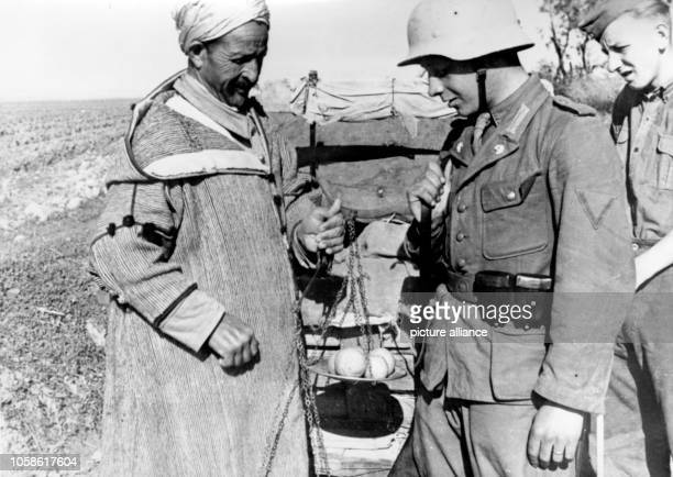 The Nazi propaganda picture shows soldiers of the German Wehrmacht with North African locals in Tunisia The photo was taken in February 1943 Photo...