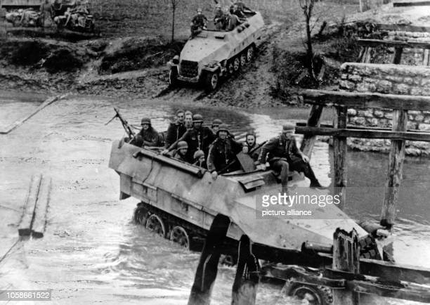 The Nazi propaganda picture shows soldiers of the German Wehrmacht fighting partisans in Yugoslavia in an armoured personnel carrier. The photo was...