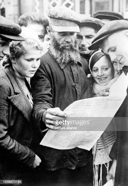 The Nazi propaganda picture shows the distribution of a newspaper to the Ukrainian population for the first time after the German occupation of Kiev...