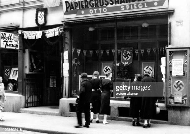 The Nazi propaganda picture shows the festively decorated city after occupation by the German army in Asch Sudetenland 1938 The original text from a...