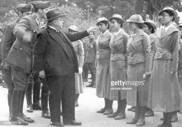 The Nazi propaganda picture shows the Greek dictator Ioannis Metaxas standing in front of members of the National Youth Organisation EON which was...