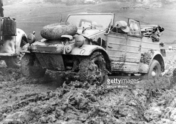 The Nazi propaganda picture shows vehicles of the German Wehrmacht in morass in Tunisia The photo was issued in March 1943 Photo Berliner Verlag /...