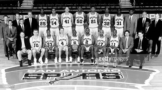 The NBA Champion San Antonio Spurs pose for a team portrait in the Alamo Dome in San Antonio TX Front row Peter Holt Andrew Gaze Antonio Daniels...