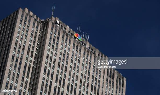 The NBC logo sits at the top of the corporate headquarters for Comcast at 30 Rock in Rockefeller Center on October 27 2017 in New York City