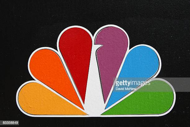 The NBC peacock logo hangs on the NBC studios building on October 20 2008 in Burbank California NBC Universal plans another round of major cuts...