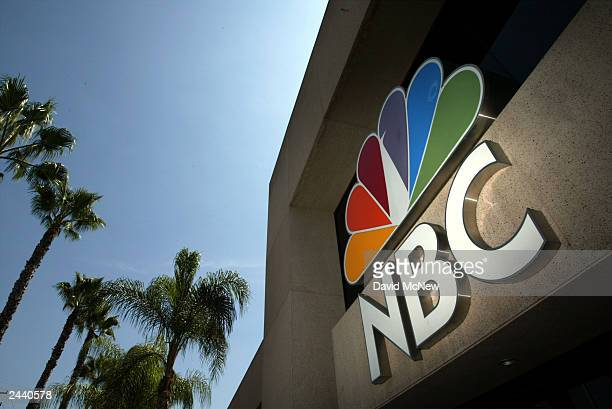 The NBC peacock logo is seen on the NBC studios building August 28 2003 in Burbank California Parisbased Vivendi is in the final stages of a long and...
