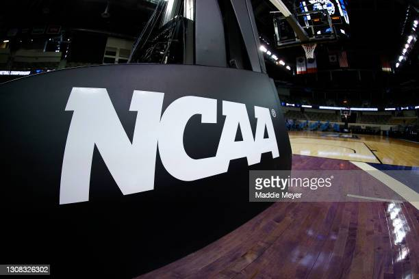 The NCAA logo is seen on the basket stanchion before the game between the Oral Roberts Golden Eagles and the Florida Gators in the second round game...