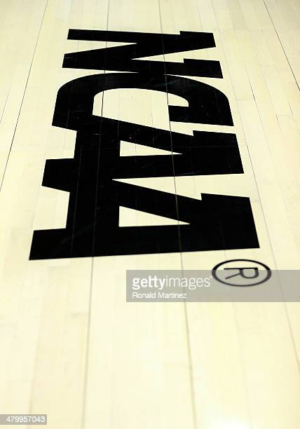 The NCAA logo is shown on the court before the start of the North Carolina Tar Heels and Providence Friars game in the second round of the 2014 NCAA...