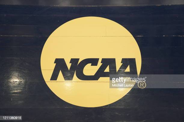 The NCAA logo on the floor during a Atlantic 10 Women's Basketball Tournament - First Round college basketball game between the Richmond Spiders and...