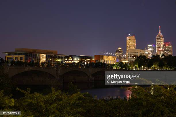 The NCAA National Office and NCAA Hall of Champions sits on the White River in front of the silhouetted Indianapolis skyline on September 21, 2020 in...