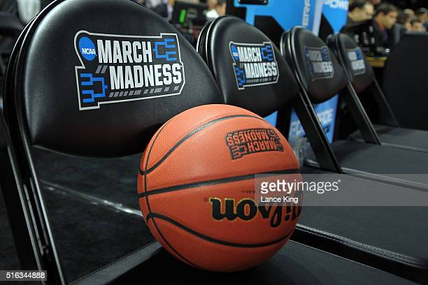 The NCAA's 'March Madness' logo is seen on a basketball and chair backs during the first round of the 2016 NCAA Men's Basketball Tournament at...
