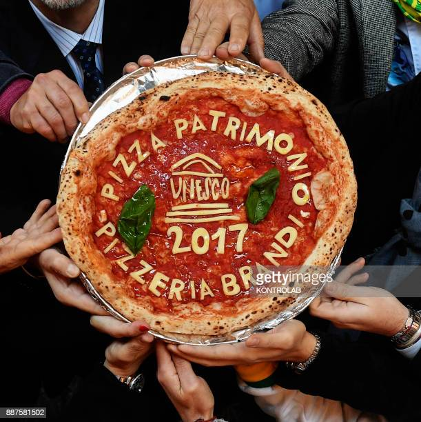 The Neapolitan pizza with the words 'Unesco' The art of the Neapolitan pizza maker is the only Italian contender to join the UNESCO world heritage...