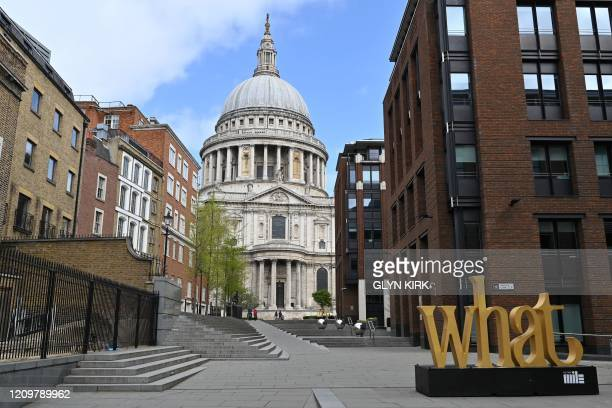 The near-deserted streets around St Paul's Cathedral are pictured as tourists stay away on the bank holiday Monday in London on April 13 as life in...
