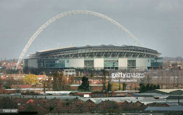 The nearly complete Wembley Stadium rises above local buildings on March 9 2007 in London The Football Association is expected to receive the keys to...