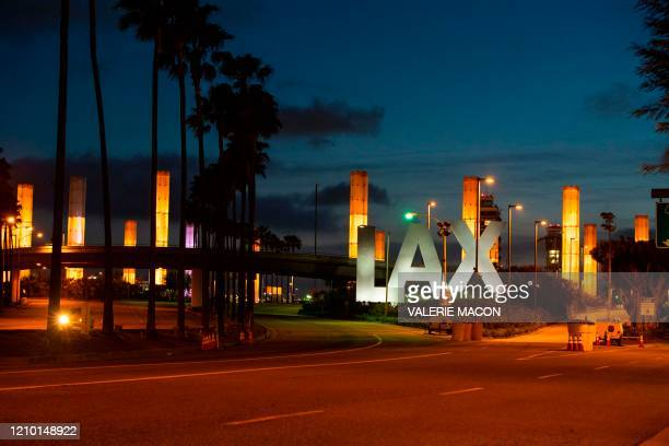 The nearly empty entrance to Los Angeles International Airport is seen during the outbreak of the novel coronavirus which causes COVID19 April 16 in...