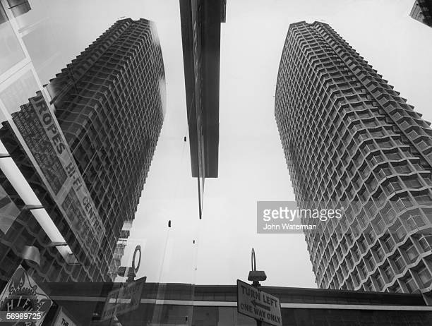 The nearlycompleted Centre Point office block in central London is reflected in the window of a nearby hifi shop 16th February 1966