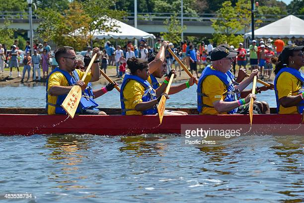 The nearperfect synchronicity in the paddling of a dragon boat team is shown by the trails of water from its crew's paddles The twoday 25th Annual...