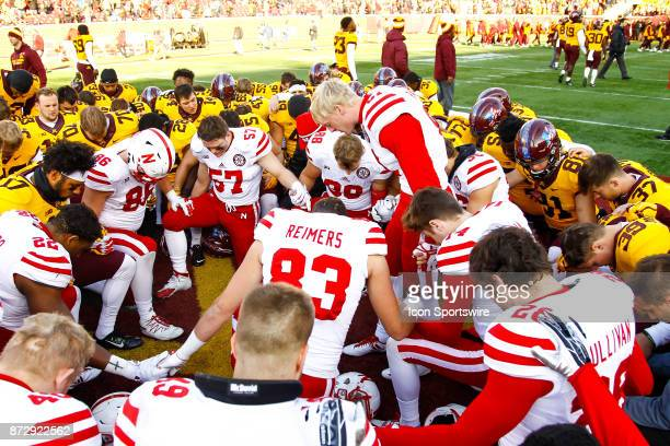 The Nebraska Cornhuskers and Minnesota Golden Gophers come together for a prayer after the Big Ten Conference game between the Nebraska Cornhuskers...