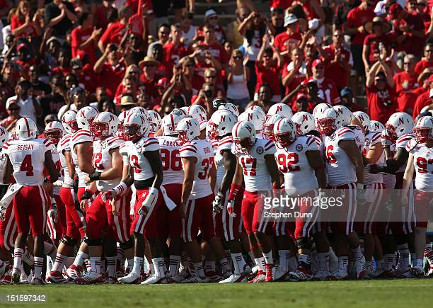The Nebraska Cornhuskers huddle in front of their cheering section before the game with the UCLA Bruins at the Rose Bowl on September 8 2012 in...